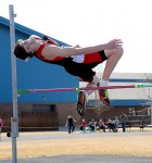Dylan  Roberts flies over the high jump bar Saturday in Greybull on his way to second place.