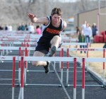 Burlington senior Garrick Tolman races to fourth place in the 110-meter high hurdles at the Riverside Invitational Friday.